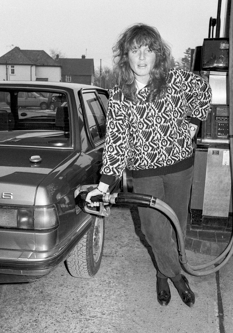 <p>Sarah Ferguson is photographed pumping her own gas in Hampshire one month before getting engaged to Prince Andrew. <br></p>