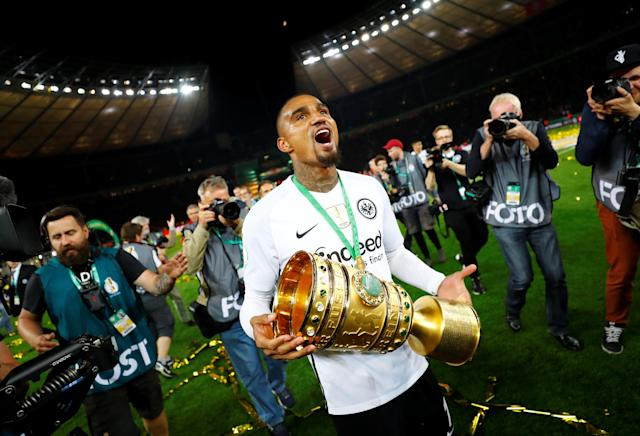Soccer Football - DFB Cup Final - Bayern Munich vs Eintracht Frankfurt - Olympiastadion, Berlin, Germany - May 19, 2018 Eintracht Frankfurt's Kevin-Prince Boateng celebrates with the trophy after winning the DFB Cup REUTERS/Kai Pfaffenbach DFB RULES PROHIBIT USE IN MMS SERVICES VIA HANDHELD DEVICES UNTIL TWO HOURS AFTER A MATCH AND ANY USAGE ON INTERNET OR ONLINE MEDIA SIMULATING VIDEO FOOTAGE DURING THE MATCH.