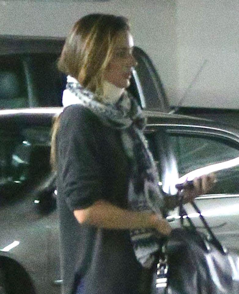 Exclusive... 51035800 Model Miranda Kerr tried hiding her neck brace under a scarf while out with a friend in Los Angeles, California on March 12, 2013. Miranda even tried to duck down in the car so no one could see her neck brace. FameFlynet, Inc - Beverly Hills, CA, USA -  1 (818) 307-4813