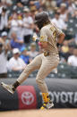 San Diego Padres' Fernando Tatis Jr., stops to make a jump before third base as he circles the bases after hitting a solo home run in the third inning of a baseball game Wednesday, June 16, 2021, in Denver. (AP Photo/David Zalubowski)