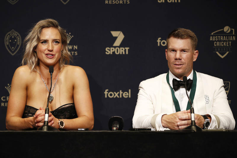 Ellyse Perry smiles next to David Warner at a press conference.