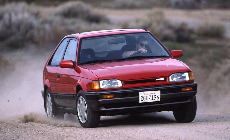 <p>Long before Ford's spicy Focus RS or Subaru's iconic WRX came into the picture, Mazda neatly filled the small, rally-bred, all-wheel-drive hatchback niche with its spunky 323 GTX. Wearing its numerical badge for U.S. sale, the GTX was a member of Mazda's long-running Familia line of small cars but was hotted up with a DOHC 16-valve turbo four that made 132 horsepower and fed all four wheels through a lockable center diff. The only real telltales that it was something more than a typical runabout were discreet badges and easily removable stickers affixed to the rear fenders—oh, and the pair of spoilers on the hatch. </p>