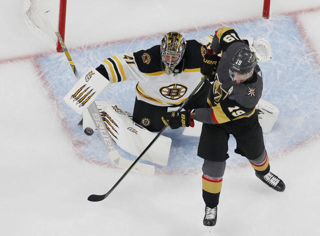 Boston Bruins goaltender Jaroslav Halak (41) blocks a shot beside Vegas Golden Knights right wing Reilly Smith (19) during the first period of an NHL hockey game Wednesday, Feb. 20, 2019, in Las Vegas. (AP Photo/John Locher)