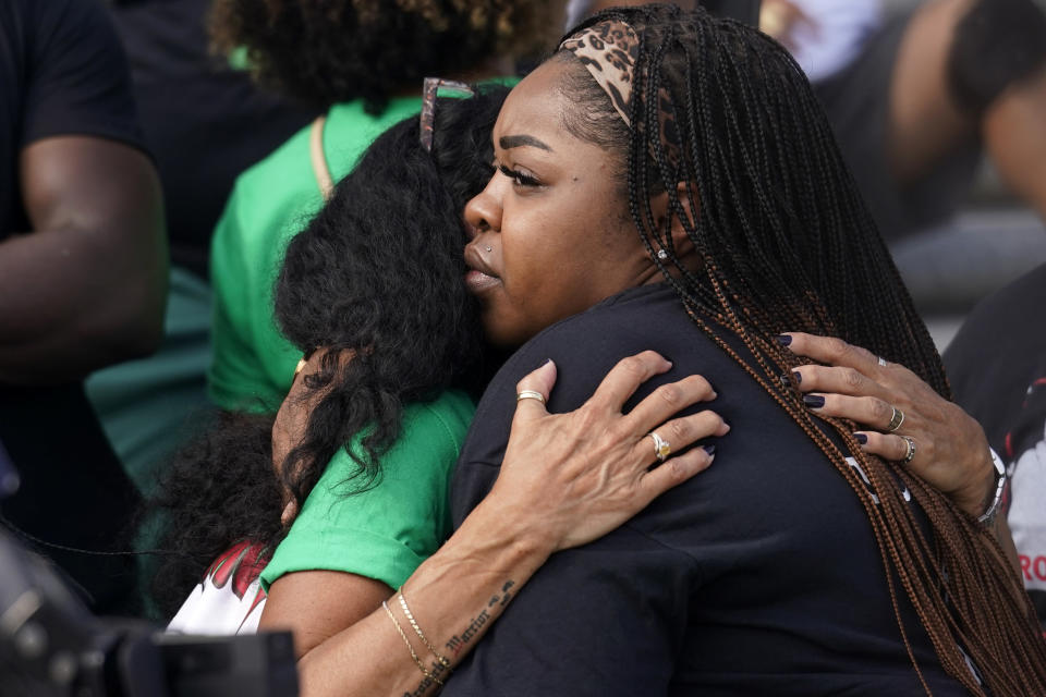 LaChay Batts, right, sister of Marvin Scott III, who died in custody in a Collin County, Texas jail in 2021, hugs Mona Hardin, mother of Ronald Greene, as they participate in a rally outside the state Capitol, in Baton Rouge, La., Thursday, May 27, 2021, protesting the death of Greene, who died in the custody of Louisiana State Police in 2019. (AP Photo/Gerald Herbert)
