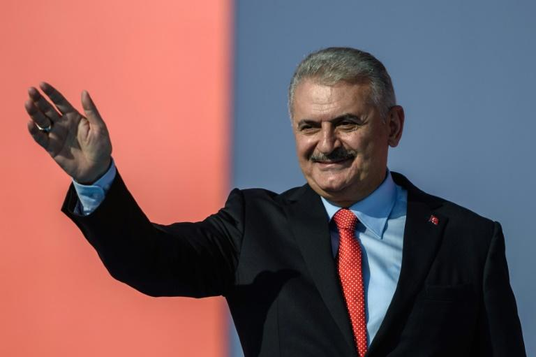 Turkish Prime Minister Binali Yildirim greets supporters on August 7, 2016 in Istanbul during a rally against failed military coup on July 15