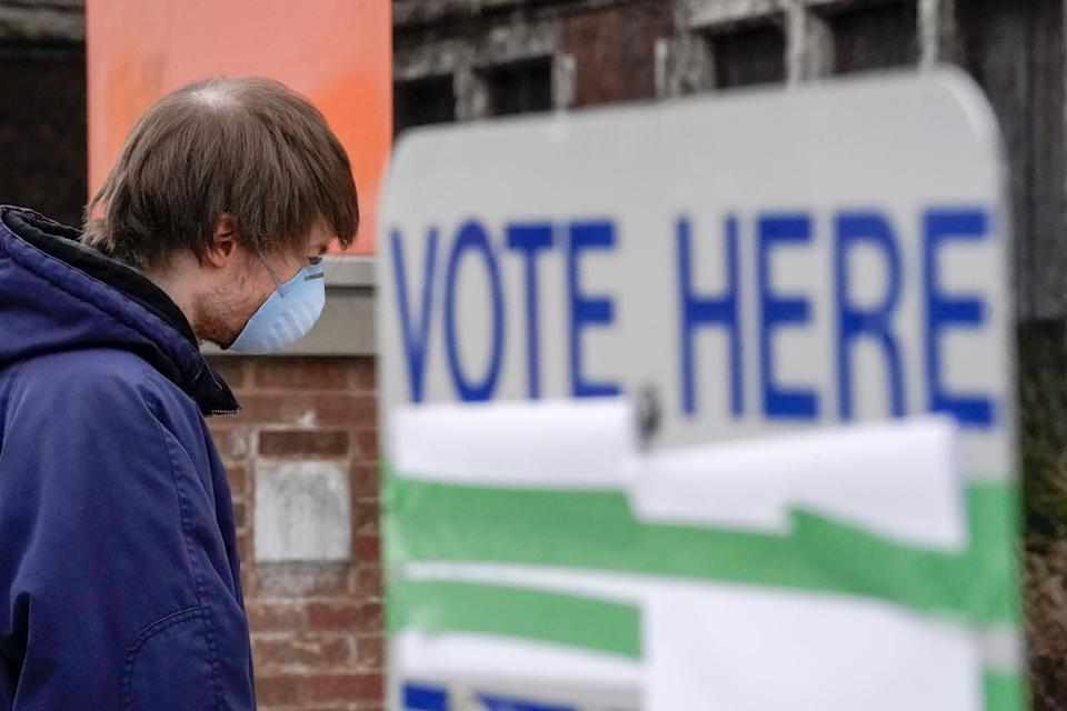 A voter in Milwaukee arrives at a polling place for Wisconsin's controversial April 7 primary election, held despite concerns about the coronavirus pandemic. (Photo: ASSOCIATED PRESS)