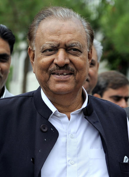 Mamnoon Hussain, a candidate from ruling party Pakistan Muslim League-N arrives to submit his nomination papers for upcoming presidential election in Islamabad, Pakistan, Wednesday, July 24, 2013. Pakistani political parties have nominated their candidates for the upcoming presidential elections with the ruling party's candidate seen as the front-runner. (AP Photo/Anjum Naveed)