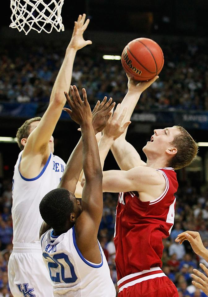 ATLANTA, GA - MARCH 23:  Cody Zeller #40 of the Indiana Hoosiers is fouled while shooting over Kyle Wiltjer #33 and  Doron Lamb #20 of the Kentucky Wildcats during the 2012 NCAA Men's Basketball South Regional Semifinal game at the Georgia Dome on March 23, 2012 in Atlanta, Georgia.  (Photo by Kevin C. Cox/Getty Images)