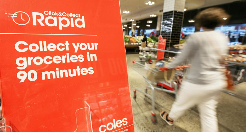 Click&Collect Rapid sign at a Coles entry.