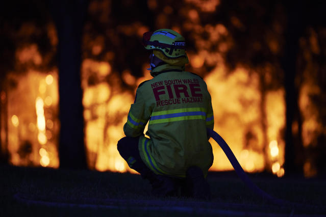 Fire crews wait at a property along Putty road as the fire front approaches on November 15, 2019 in Colo Heights, Australia. The warning has been issued for a 80,000-hectare blaze at Gospers Mountain, which is burning in the direction of Colo Heights. An estimated million hectares of land has been burned by bushfire across Australia following catastrophic fire conditions - the highest possible level of bushfire danger - in the past week. A state of emergency was declared by NSW Premier Gladys Berejiklian on Monday 11 November and is still in effect, giving emergency powers to Rural Fire Service Commissioner Shane Fitzsimmons and prohibiting fires across the state. Four people have died following the bushfires in NSW this week. (Photo by Brett Hemmings/Getty Images)