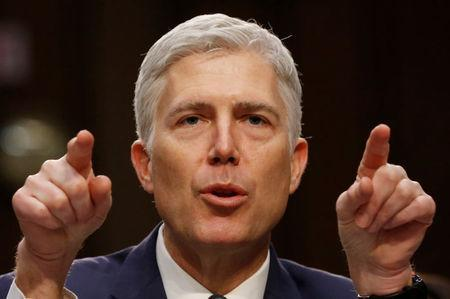 FILE PHOTO - U.S. Supreme Court nominee judge Neil Gorsuch testifies during a third day of his Senate Judiciary Committee confirmation hearing on Capitol Hill in Washington, U.S., March 22, 2017. REUTERS/Jonathan Ernst/File Photo