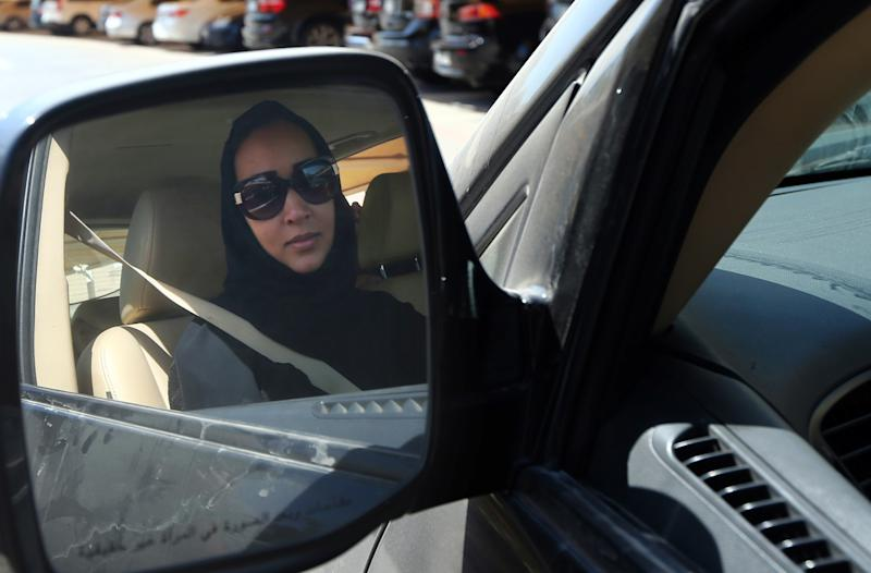 Saudi activist Manal Al Sharif drives her car in Dubai on October 22, 2013, as she campaigns for women's rights to drive in the country (AFP Photo/Marwan Naamani)
