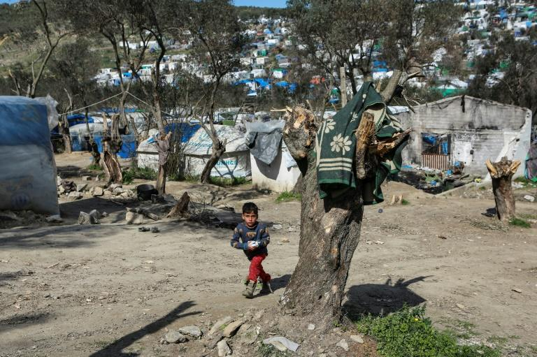 Officials are racing to avoid contagion among tens of thousands of migrants in overcrowded camps nationwide