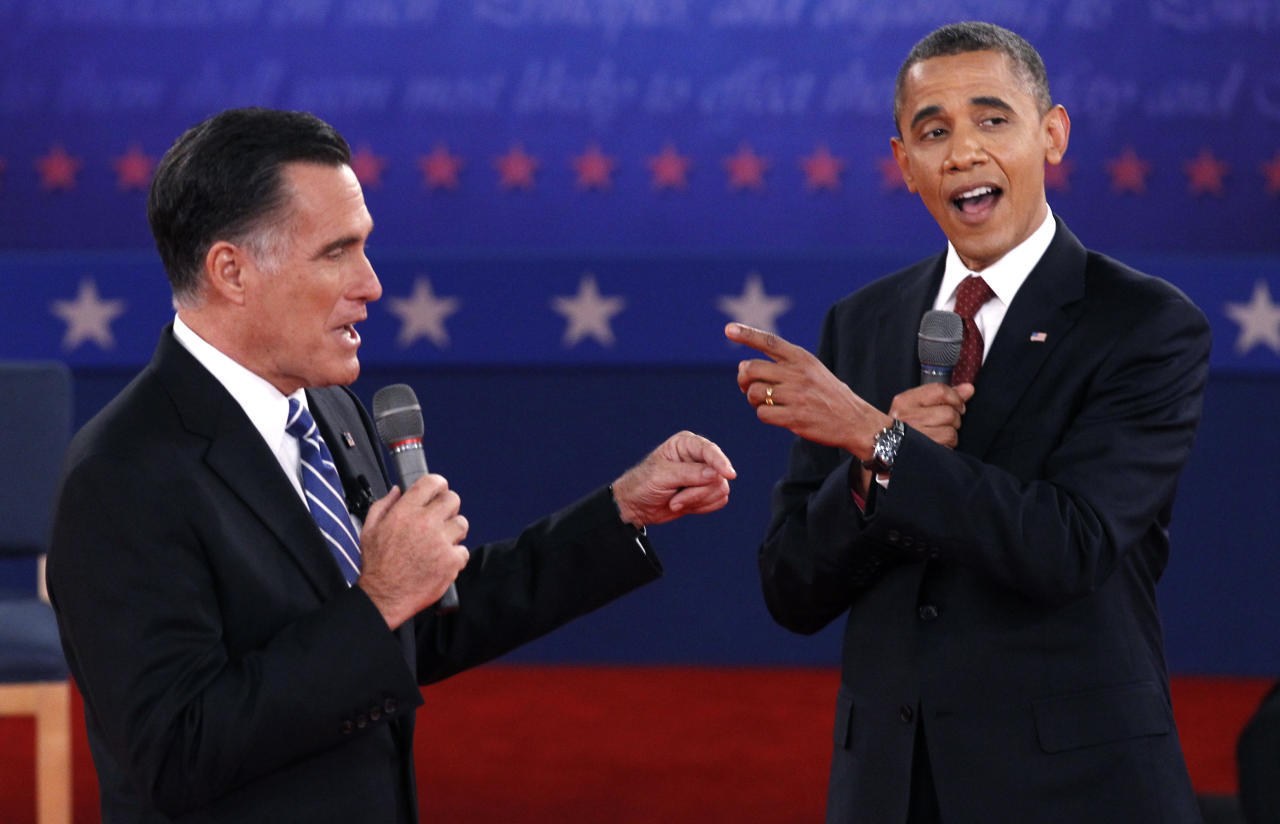 U.S. Republican presidential nominee Mitt Romney (L) and U.S. President Barack Obama answer a question at the same time during the second U.S. presidential campaign debate in Hempstead, New York, October 16, 2012. REUTERS/Jim Young (UNITED STATES  - Tags: POLITICS ELECTIONS USA PRESIDENTIAL ELECTION)