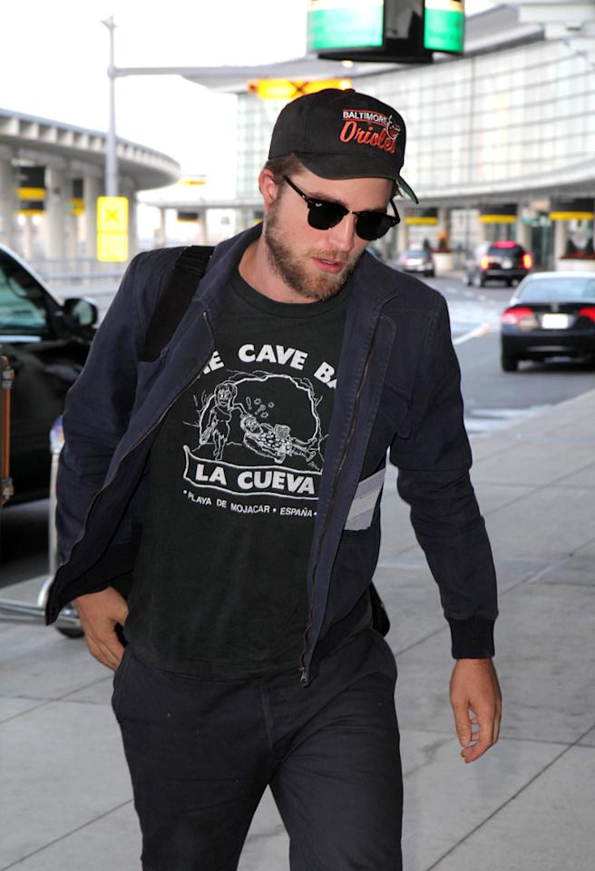"""Robert Pattinson """"snapped"""" and """"nearly"""" attacked a paparazzo, reports X17Online. The site says after the """"Twilight"""" star left a meeting in L.A. in """"a very bad mood,"""" its """"photographer kept a respectful distance ... but all of a sudden Pattinson snapped, clenching his fists and nearly throwing a punch at the camera."""" For the scoop behind what set Pattinson off, and the only reason he didn't hit the paparazzo, see what an insider reveals to <a href=""""http://www.gossipcop.com/robert-pattinson-attacking-paparazzi-photographer-punch-fists-pictures-video-x17/"""" target=""""new"""">Gossip Cop</a>. O'Neill/White/<a href=""""http://www.infdaily.com"""" target=""""new"""">INFDaily.com</a> - September 29, 2011"""
