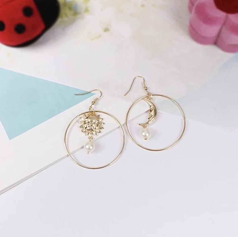 <p>These <span>Sun Moon Asymmetric Imitation Pearl Earrings</span> ($5) will elevate any look.</p>