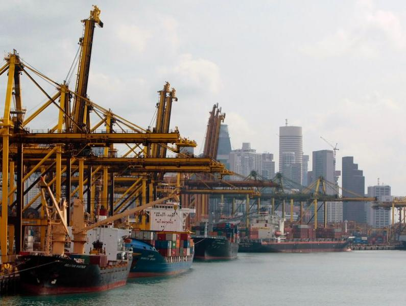 Container ships are seen berthed at the Brani container terminal near Singapore's financial district