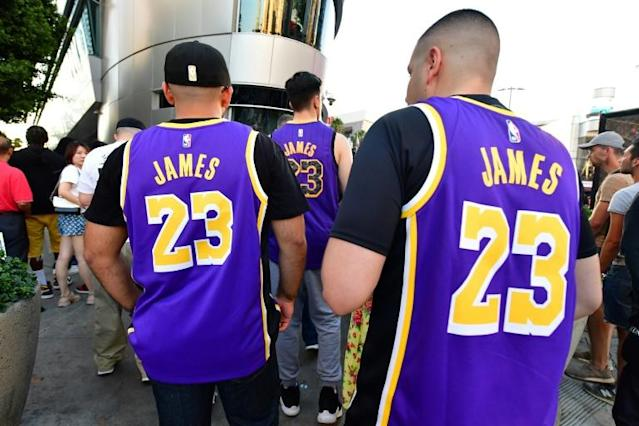 Los Angeles Lakers fans wearing Lebron James jerseys have helped boost the club among the five most valued sports franchises in North America according to the latest annual analysis of NBA business figures released Tuesday by Forbes magazine (AFP Photo/Frederic J. BROWN)
