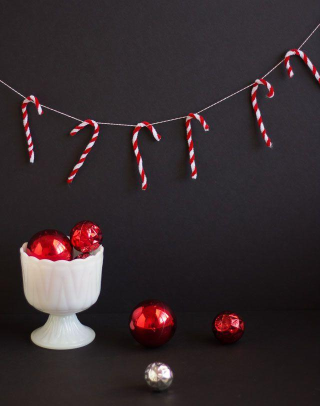 """<p>Twist pipe cleaners into candy cane shapes, then secure then on baker's twine to create a Christmas garland fit for your tree or kitchen shelf. </p><p><a href=""""https://designimprovised.com/2013/12/christmas-garland.html"""" rel=""""nofollow noopener"""" target=""""_blank"""" data-ylk=""""slk:Get the tutorial."""" class=""""link rapid-noclick-resp"""">Get the tutorial.</a></p><p><a class=""""link rapid-noclick-resp"""" href=""""https://www.amazon.com/Caydo-Christmas-Cleaners-Creative-Decorations/dp/B0815R39DQ?tag=syn-yahoo-20&ascsubtag=%5Bartid%7C10072.g.37499128%5Bsrc%7Cyahoo-us"""" rel=""""nofollow noopener"""" target=""""_blank"""" data-ylk=""""slk:SHOP PIPE CLEANERS"""">SHOP PIPE CLEANERS</a></p>"""