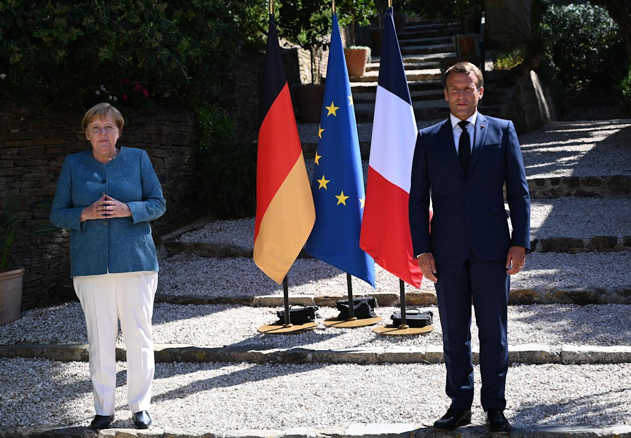 French President Emmanuel Macron (R) and German Chancellor Angela Merkel. Both nations have seen a sharp rise in coronavirus cases in recent weeks. (Getty)