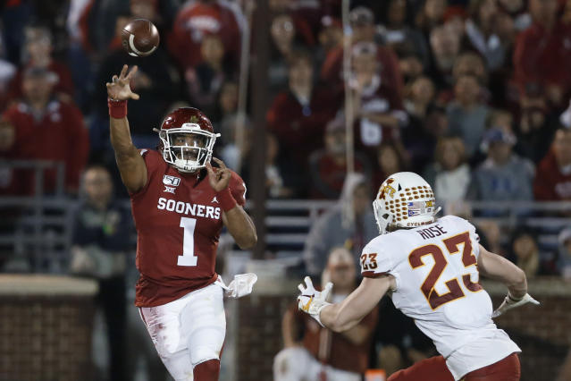 Oklahoma quarterback Jalen Hurts (1) throws under pressure from Iowa State linebacker Mike Rose (23) during the first quarter of an NCAA college football game in Norman, Okla., Saturday, Nov. 9, 2019. (AP Photo/Sue Ogrocki)