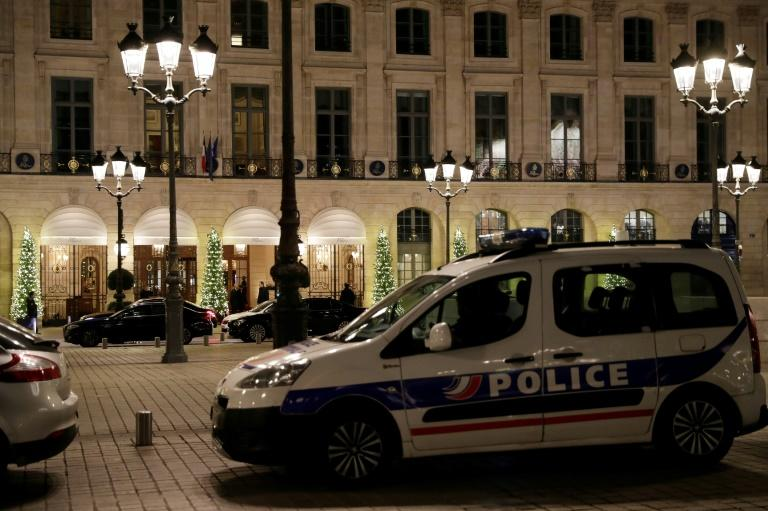 Five men armed with handguns and hatchets smashed the display windows of jewellery shops in the Ritz hotel on the luxurious Place Vendome in Paris