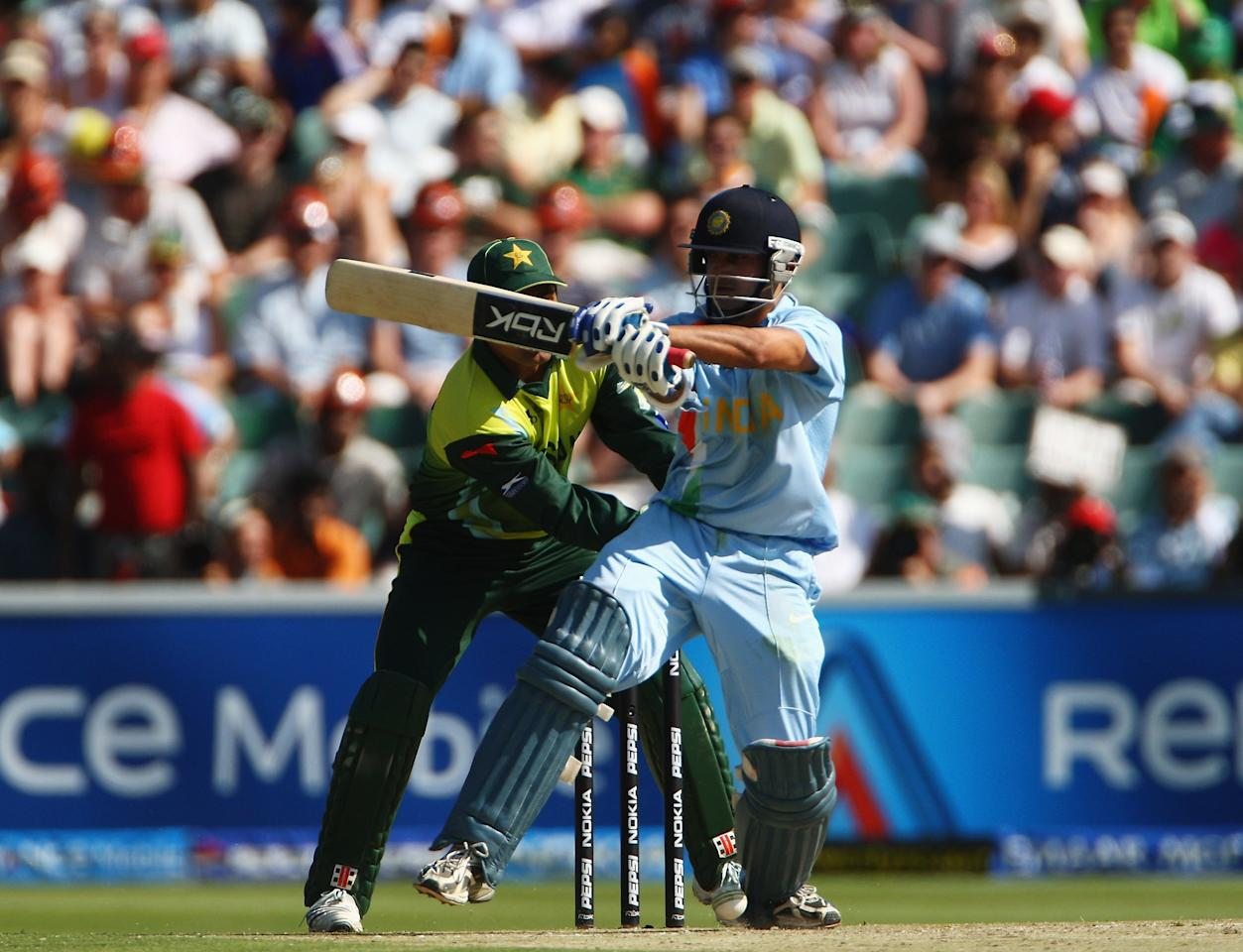 JOHANNESBURG, SOUTH AFRICA - SEPTEMBER 24:  Gautam Gambhir of India hits out during the Twenty20 Championship Final match between Pakistan and India at The Wanderers Stadium on September 24, 2007 in Johannesburg, South Africa.  (Photo by Tom Shaw/Getty Images)