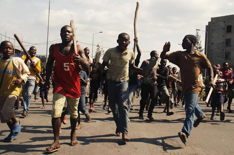 Angry residents take to the streets to protest recent violence including mortar attacks that have struck homes and churches in the eastern provincial capital, killing at least seven civilians and wounding dozens of others, in Goma, Congo, Saturday, Aug. 24, 2013. Congolese soldiers supported by U.N. forces fought rebels in the country's deteriorating east for hours early Saturday, officials said, while a deadly rocket landed inside the town of Goma. Congo immediately blamed the attacks on neighboring Rwanda, which has long been accused of supporting the eastern Congolese rebel movement known as M23. (AP Photo/Joseph Kay)
