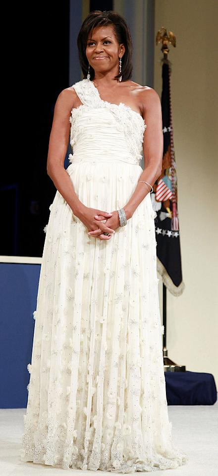 """Michelle Obama chose a chiffon creation by 26-year-old designer Jason Wu as her inauguration ball gown. It was a bold choice going with a relative unknown, but with a night full of events, we're not sure white was the way to go. Mark Wilson/<a href=""""http://www.gettyimages.com/"""" target=""""new"""">GettyImages.com</a> - January 20, 2009"""