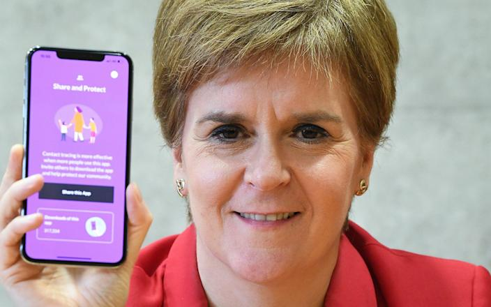 Nicola Sturgeon's call on the public to download the app was backed by other political leaders - Jeff J Mitchell/Getty