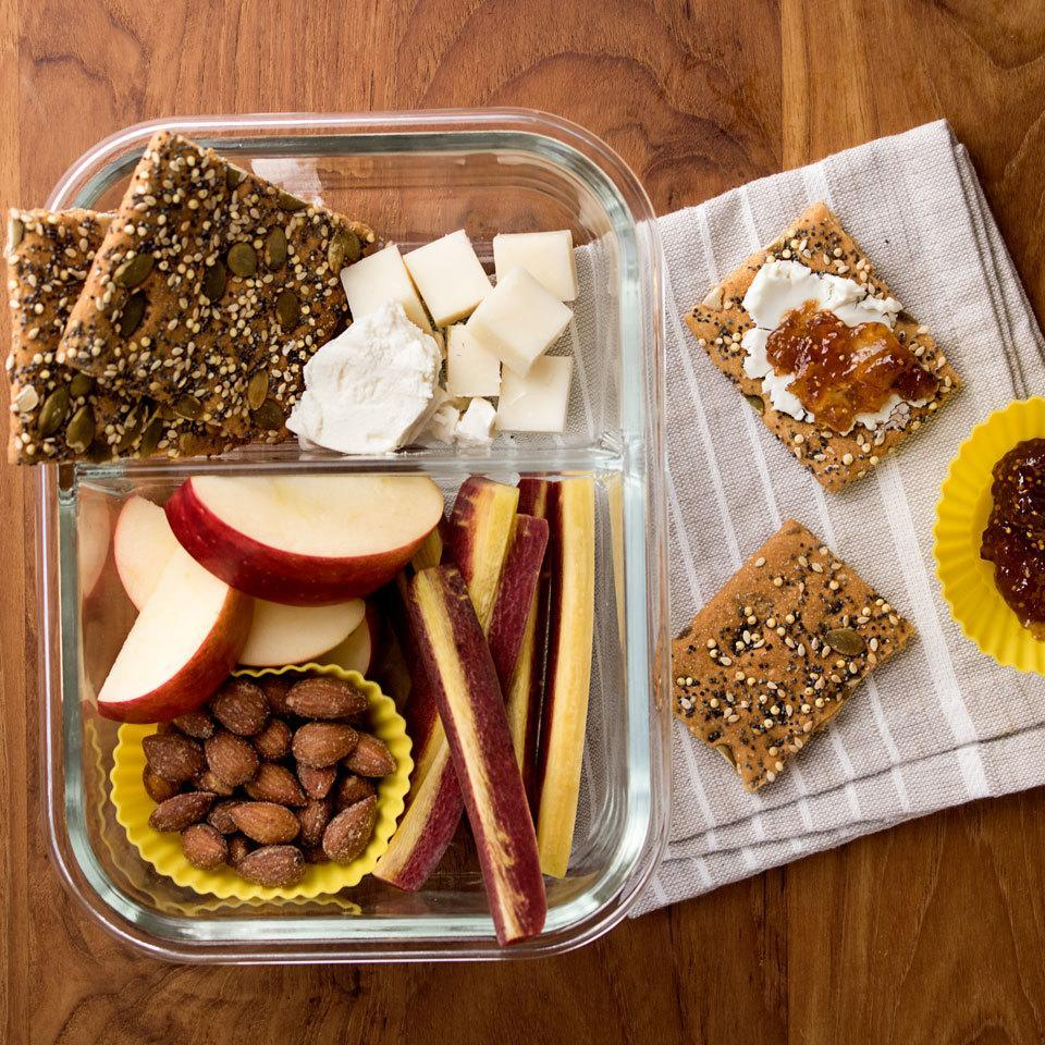 """<p>This fruit, cheese and cracker box inspired by Starbucks' bistro boxes is a fun and healthy alternative to your standard sandwich. It's the perfect personal-size cheese plate to pack for a work lunch or a picnic in the park. <a href=""""https://www.eatingwell.com/recipe/264677/fruit-cheese-bistro-lunch-box/"""" rel=""""nofollow noopener"""" target=""""_blank"""" data-ylk=""""slk:View Recipe"""" class=""""link rapid-noclick-resp"""">View Recipe</a></p>"""