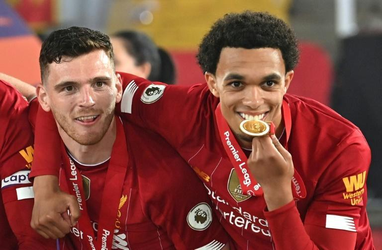 Wingmen: Andy Robertson (left) and Trent Alexander-Arnold (right) have been key to Liverpool winning the Premier League and Champions League under Jurgen Klopp