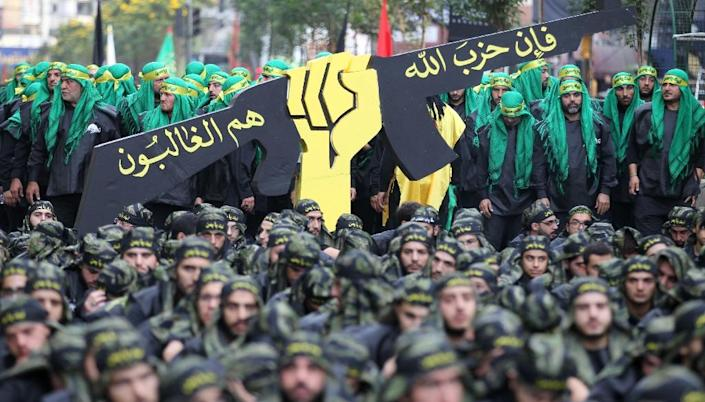 Hezbollah members are seen during Ashura commemorations in southern Beirut in October 2016 (AFP Photo/ANWAR AMRO)