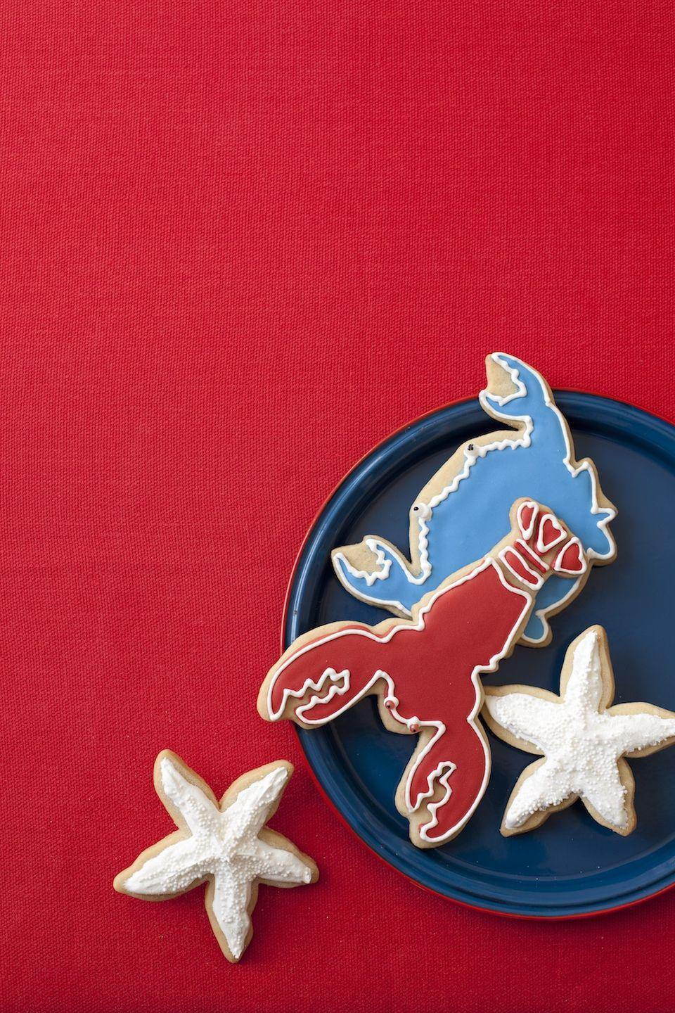 """<p>These sugar cookies just scream summer. The red, white and blue icing really drives the message home. </p><p><em><strong><a href=""""https://www.womansday.com/food-recipes/food-drinks/recipes/a11012/seaside-cookies-recipe-122376/"""" rel=""""nofollow noopener"""" target=""""_blank"""" data-ylk=""""slk:Get the Seaside Cookies recipe."""" class=""""link rapid-noclick-resp"""">Get the Seaside Cookies <em>recipe</em>. </a></strong></em></p>"""