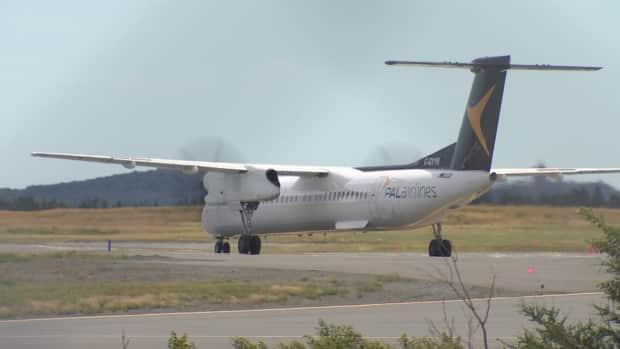 The first PAL Airlines flight from Ottawa and St. John's arrives on the runway Friday afternoon. The route is one of 12 new flights announced by the airline in June. (CBC - image credit)