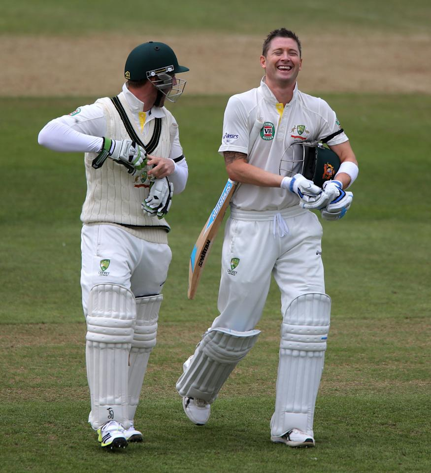 Australia's Michael Clarke (right) share a joke with Phil Hughes during the International Tour match at the County Ground, Taunton.