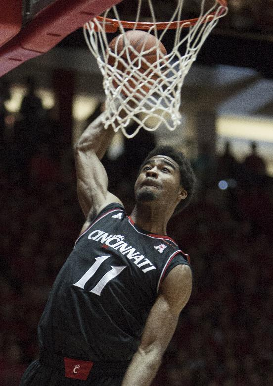 Cincinnati's Jermaine Lawrence dunks the ball during the first half of an NCAA college basketball game against New Mexico, Saturday, Dec. 7, 2013, in Albuquerque, NM. (AP Photo/Craig Fritz)