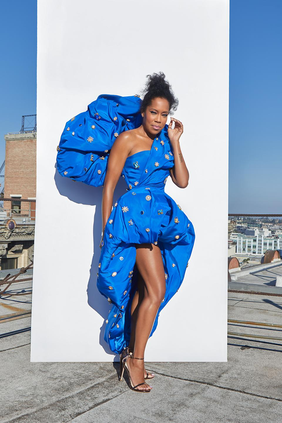 """<h2>Regina King in Schiaparelli<br></h2><br>To ensure that Regina King's electric blue Schiaparelli gown didn't go unseen despite the lack of an Emmys red carpet, photographer <a href=""""https://www.instagram.com/iamjamesanthony/"""" rel=""""nofollow noopener"""" target=""""_blank"""" data-ylk=""""slk:James Anthony"""" class=""""link rapid-noclick-resp"""">James Anthony</a> held a shoot with the <em>Watchmen</em> star prior to the awards show. And boy, are we glad he did."""