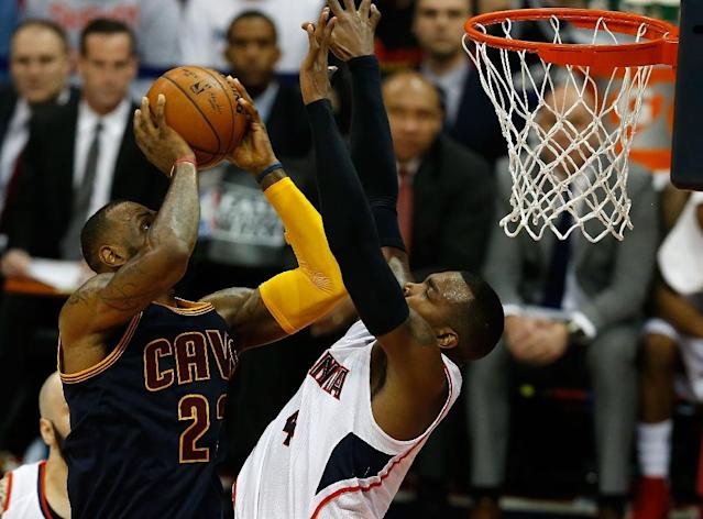 LeBron James (left) of the Cleveland Cavaliers shoots over Paul Millsap of the Atlanta Hawks during game one of the Eastern Conference finals at Philips Arena on May 20, 2015 in Atlanta, Georgia (AFP Photo/Mike Zarrilli)