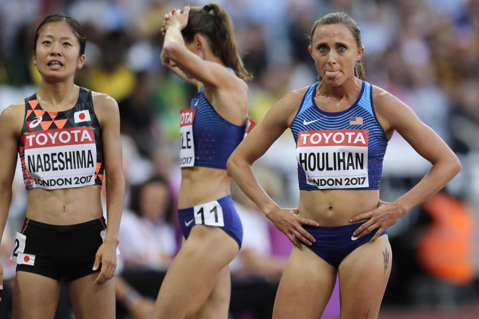 FILE - United States' Shelby Houlihan, right, reacts after finishing a women's 5000m heat during the World Athletics Championships in London, in this Thursday, Aug. 10, 2017, file photo. Banned runner Shelby Houlihan is in the lineup and will be allowed to run at U.S. Olympic track trials while any appeals she files are pending. The American record holder at 1,500 and 5,000 meters, Houlihan is on the start list for Friday's, June 18, 2021, 5,000 preliminaries. (AP Photo/Tim Ireland, File)