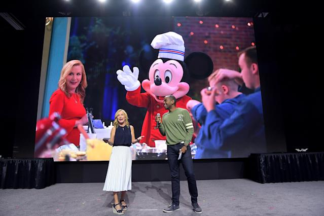 """ANAHEIM, CALIFORNIA - AUGUST 25: (L-R) Angela Kinsey of """"Be Our Chef"""" and Albert Lawrence speak at the Disney+ Pavilion at Disney's D23 EXPO 2019 in Anaheim, Calif. """"Be Our Chef"""" will stream exclusively on Disney+, which launches on November 12. (Photo by Charley Gallay/Getty Images for Disney+)"""