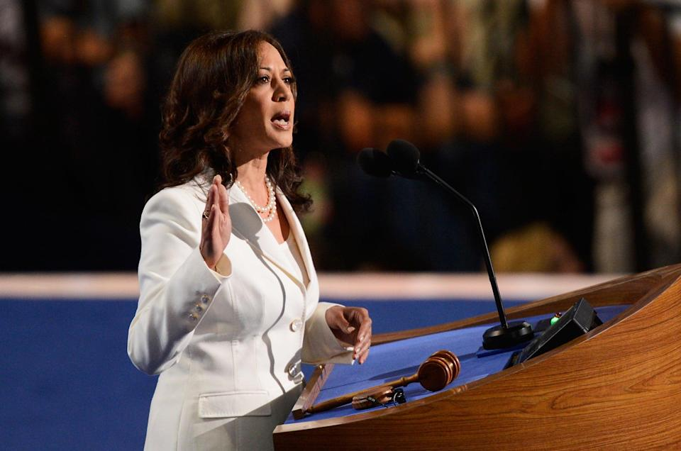 <p>Kamala wore white at the DNC in 2012, which officially nominated Barack Obama as the presidential candidate for the second time. She needed little more than her trusty pearls to complete this ivory pantsuit that came with marble buttons.</p>