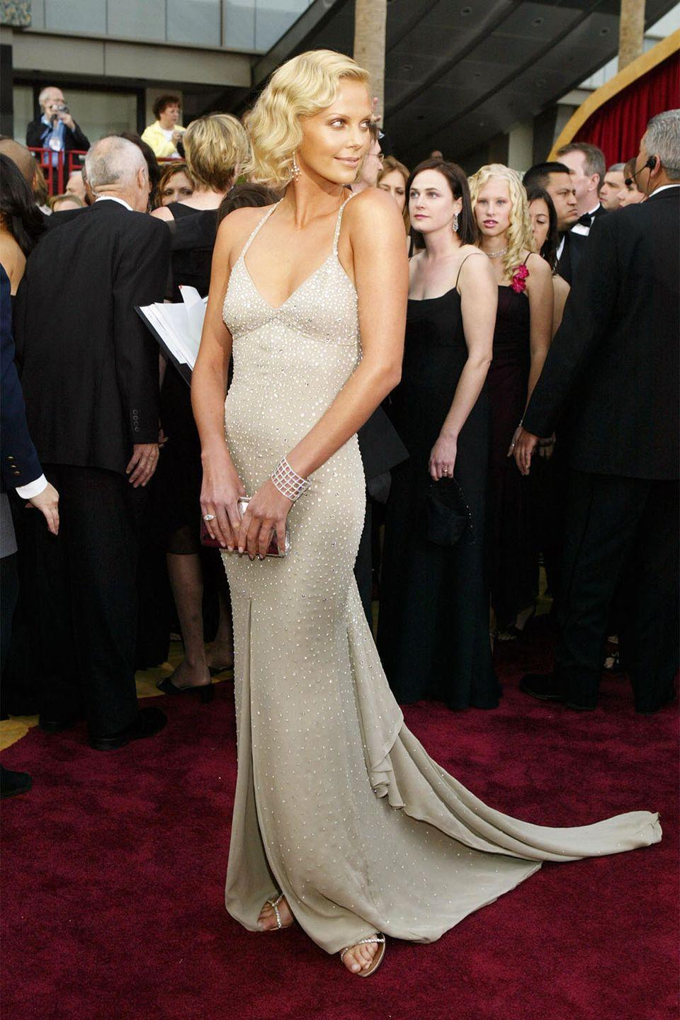 <p>Charlize Theron won big in 2004 for <em>Monster</em> with her Dior gown sparkling against her tanned skin.</p>