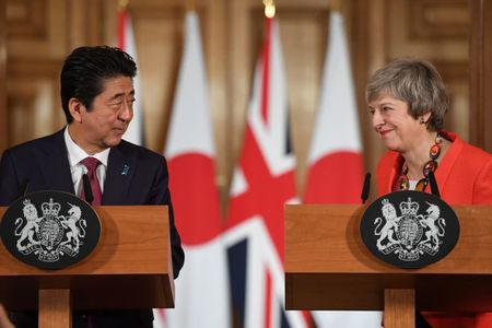 British Prime Minister Theresa May and Japanese Prime Minister Shinzo Abe hold a news conference after a bilateral meeting in London