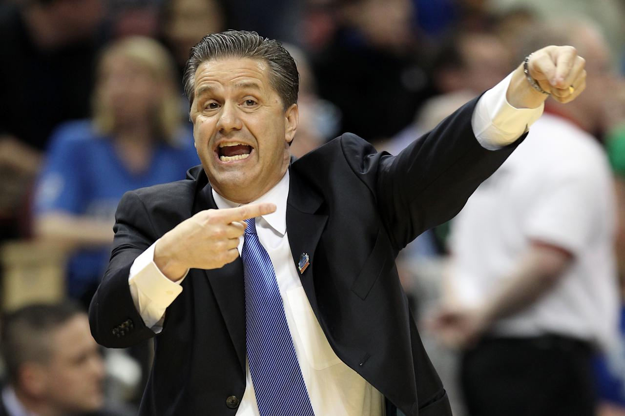 LOUISVILLE, KY - MARCH 17:  Head coach John Calipari of the Kentucky Wildcats coaches in the first half against the Iowa State Cyclones during the third round of the 2012 NCAA Men's Basketball Tournament at KFC YUM! Center on March 15, 2012 in Louisville, Kentucky.  (Photo by Andy Lyons/Getty Images)