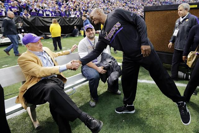 Minnesota Vikings running back Adrian Peterson, right, greets former Vikings coach Bud Grant following an NFL football game against the Detroit Lions, Sunday, Dec. 29, 2013, at Mall of America Field at the Hubert H. Humphrey Metrodome in Minneapolis. The Vikings were playing their final game in the Metrodome, as it will be torn down following the season. (AP Photo/Ann Heisenfelt)