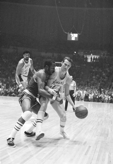 Lakers' Jerry West tries to take the ball down the court against Boston's Emmette Bryant during Game 1 of the 1969 NBA Finals