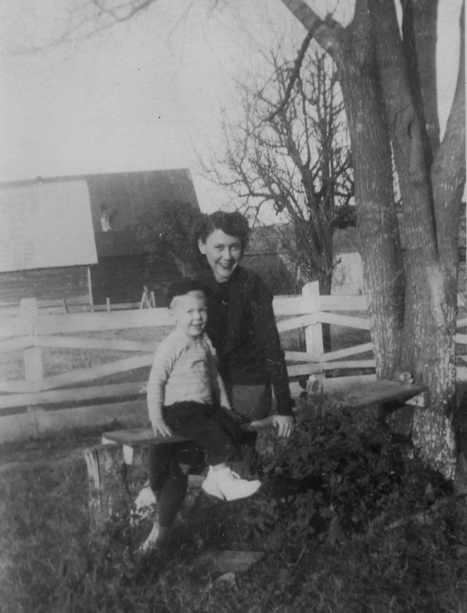 """In this image provided by the McConnell Center at the University of Louisville, Mitch McConnell sits with his mother Julia """"Dean"""" McConnell on a bench in this image from the mid 1940's in Five Points, Ala.. As the coronavirus pandemic unfolds, Senate Majority Leader Mitch McConnell flashes back to an earlier crisis that gripped the nation, and his own life, when he was a boy. He was struck with polio. (McConnell Center at the University of Louisville via AP)"""