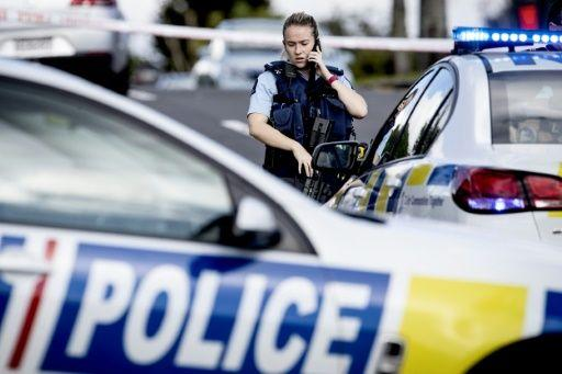Officer at the scene of the shooting in a residential neighbourhood in Auckland. Source: AFP