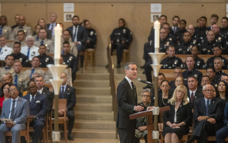 Los Angeles Mayor Eric Garcetti eulogizes slain Los Angeles Police  officer Juan Diaz during funeral mass at the Cathedral of Our Lady of the Angels in Los Angeles, Calif., on Monday, Aug. 12, 2019. (Brian van der Brug/Los Angeles Times via AP, Pool)